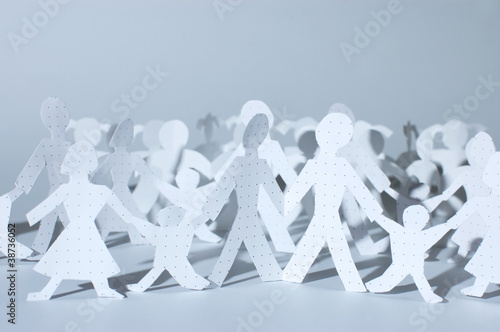Paper people chain: men, women and babies. Family concept.