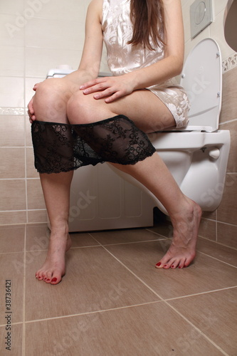 sitting - in the toilet