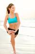 Sport fitness woman training on beach