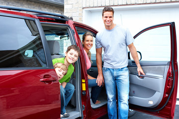 Happy family and a family car.