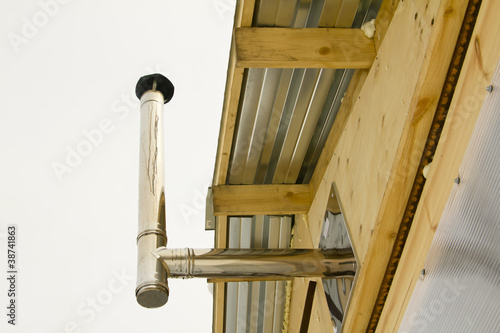 wooden house wiht heating pipe in winter