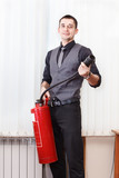 White collar worker with fire-extinguisher in office room