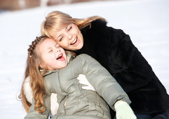 mother and daughter enjoying beautiful winter day