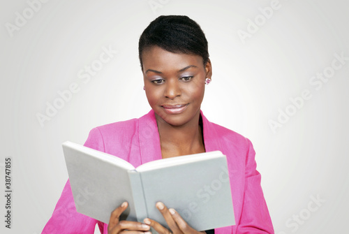 Beautiful woman reading a book with relaxed smile