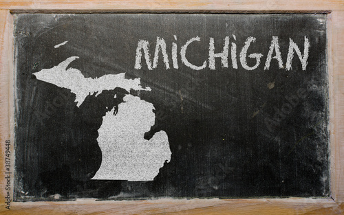 outline map of us state of michigan on blackboard