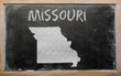 outline map of us state of missouri on blackboard