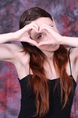 heart with human hands of y young woman