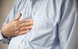 businessman with heartburn pain