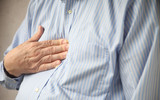 businessman with heartburn pain