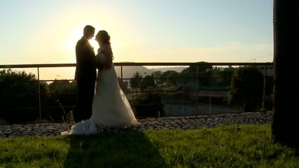the wedding kiss at sunset