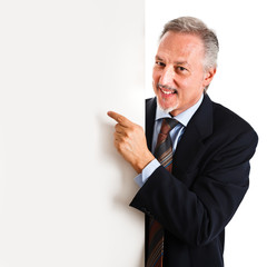 Friendly businessman pointing a Blank Board