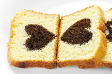closeup view of two slices of cake with cocoa heart inside