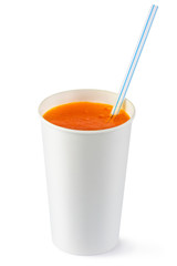 Disposable cup of orange fizzy drink and straw