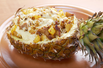 roast meat with cheese  grilled  in pineapple