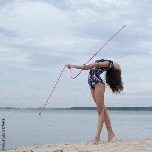 Young gymnast girl dance with skipping rope