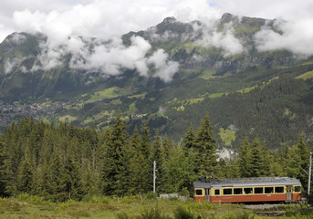 Murren train passing beneath slopes of Lauberhorn