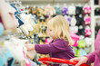 Mother and daughter in shoes section in supermarket
