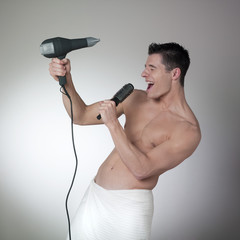 athletic man singing after the shower