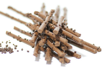 Chocolate sticks with chocolate granules isolated