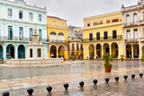 Raining in La Plaza Vieja,a landmark in Old Havana poster