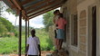 Painting the exterior of a school in a village in Kenya.