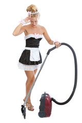 tired maid with vacuum cleaner