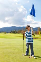 Boy with a golf flag