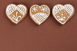 Gingerbread hearts on brown background
