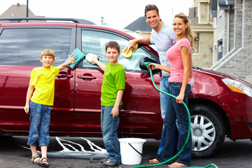 Happy family washing the family car.