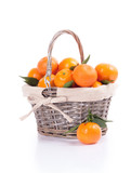 tangerines with leaves in a beautiful basket isolated