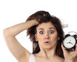 Surprised woman holding clock