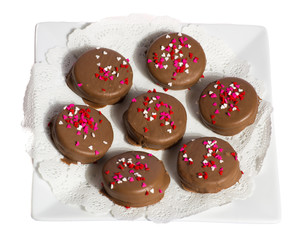 Plate of seven chocolate cookies wit hhearts