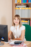 businesswoman working in office room