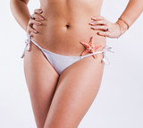 Beautiful tanned body of a young woman poster