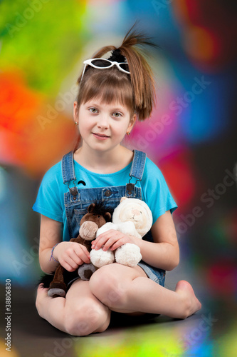 young happy girl. little girl on colorful background.