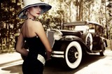 Woman in hat against retro car.