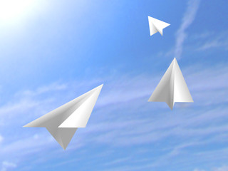 origami paper white airplanes flying on the sky
