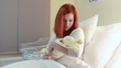 Redhead women with newborn baby