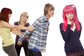 Two girls keep the guy which reaches to the girl in a pink wig