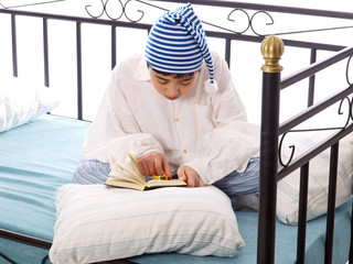 boy in nightshirt and sleeping cap