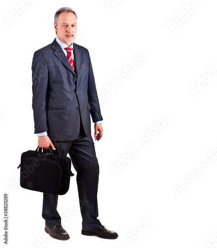 Full length businessman holding briefcase