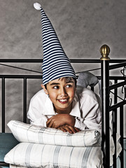 smiling boy in pajama and nightcap