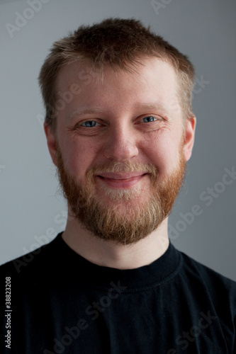 Young upbeat guy with a beard