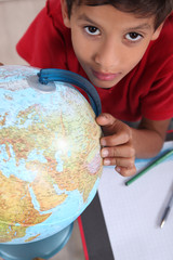 schoolboy interested in geography