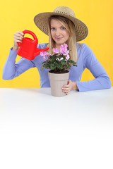 Woman tending to her plant