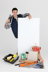 Young tiler pointing white board for message