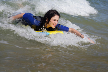 Woman bodyboarding