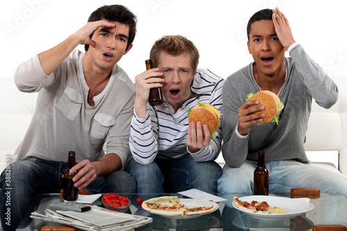 Group of friends watching a football game