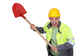 Angry construction worker holding spade
