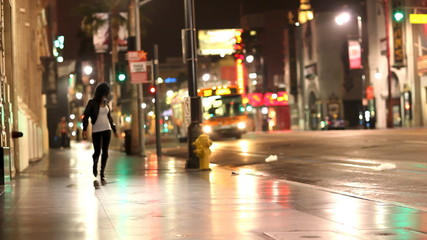 Woman Walking City Street at Night